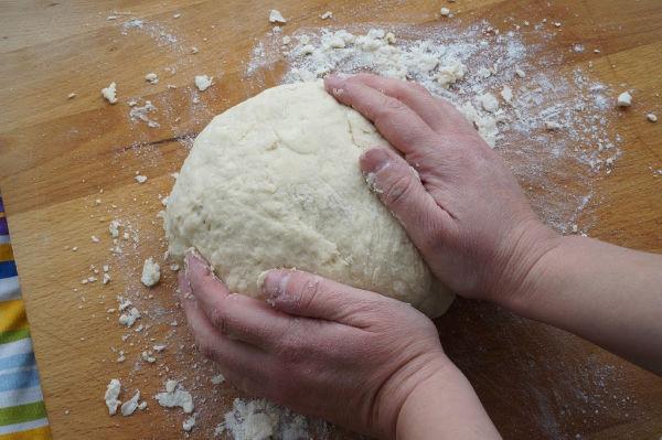 kneading soda bread ball of dough