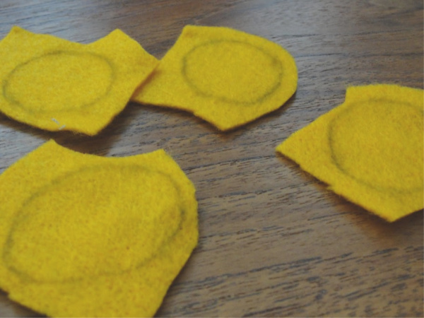 felt pumpkins ready to be cut out