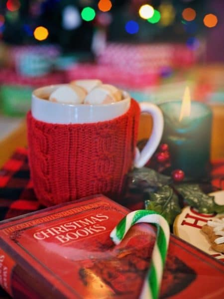 christmas book with hot chocolate