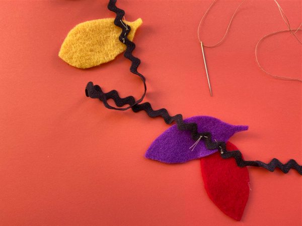 fall felt leaves sewing on garland with needle and thread