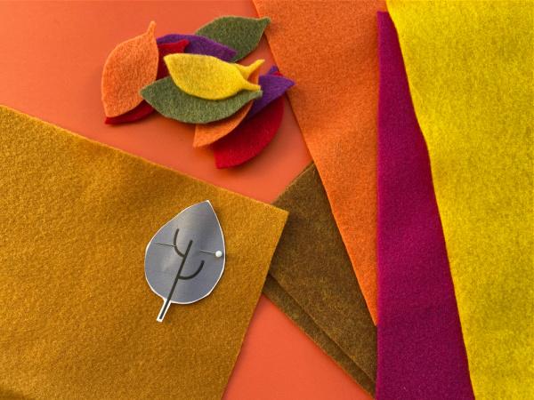 leaf template pinned to felt sheet