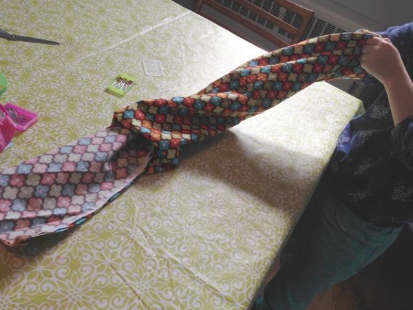 child turning infinity scarf right way round