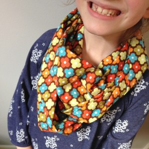 happy child wearing infinity scarf