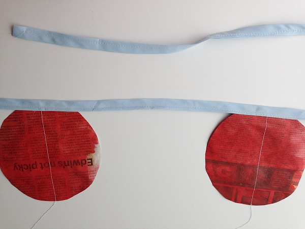 blue bias tape sewn on red discs