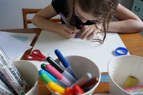 drawing on plastic lid