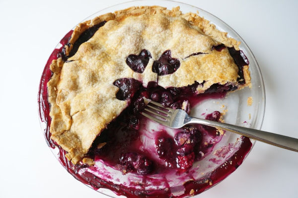 blueberry pie baked with fork
