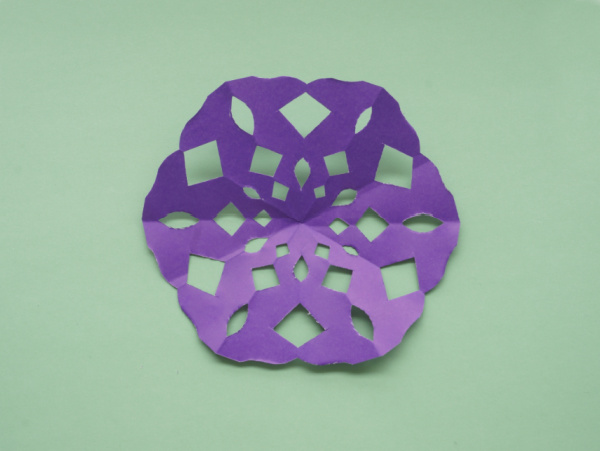 final purple paper snowflake unfolded