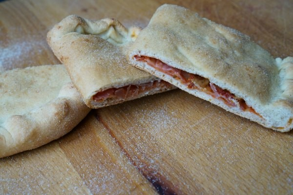 pizza filled calzone baked