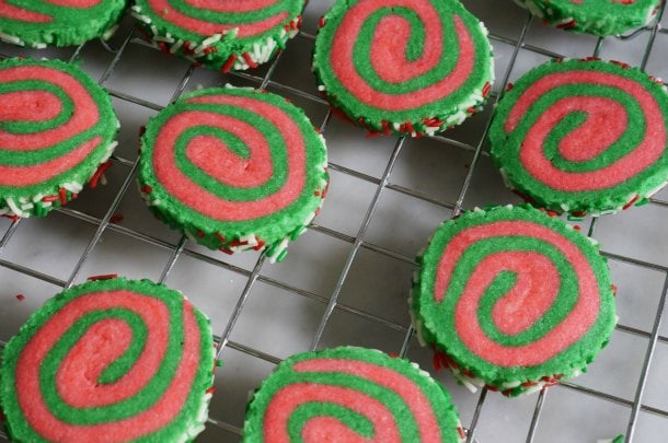 christmas pinwheel cookies on cooling rack