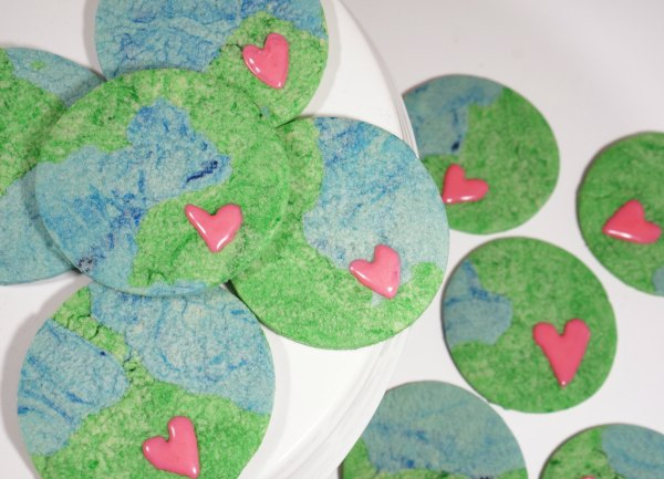 Earth Day sugar cookies on plate earth with heart