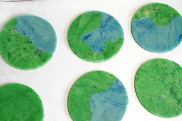 Earth Day cookie cut out on baking sheet