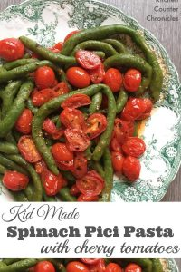 Kid Made Spinach Pici Pasta with Cherry Tomato Sauce - Get the kids in the kitchen making pasta from scratch. This pasta is packed with healthy spinach...the kids are going to love making this and eating it too. | Kids in the kitchen | Family Pasta Recipe | Homemade Pasta Recipe | Cooking with Kids | Vegetarian Recipe for Kids |