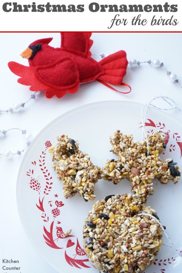 Bird Seed Christmas Ornaments - Celebrate Christmas with the birds. These ornaments are simple to make and looks so lovely hanging outside in a tree. Make them with the kids and watch the birds flock to your yard to eat a holiday treat. | Kids in the Kitchen | Christmas Ornaments | Handmade Christmas | Make a Bird Feeder | Bird Seed Ornament |