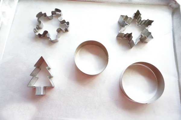 christmas cookie cutters on parchment paper