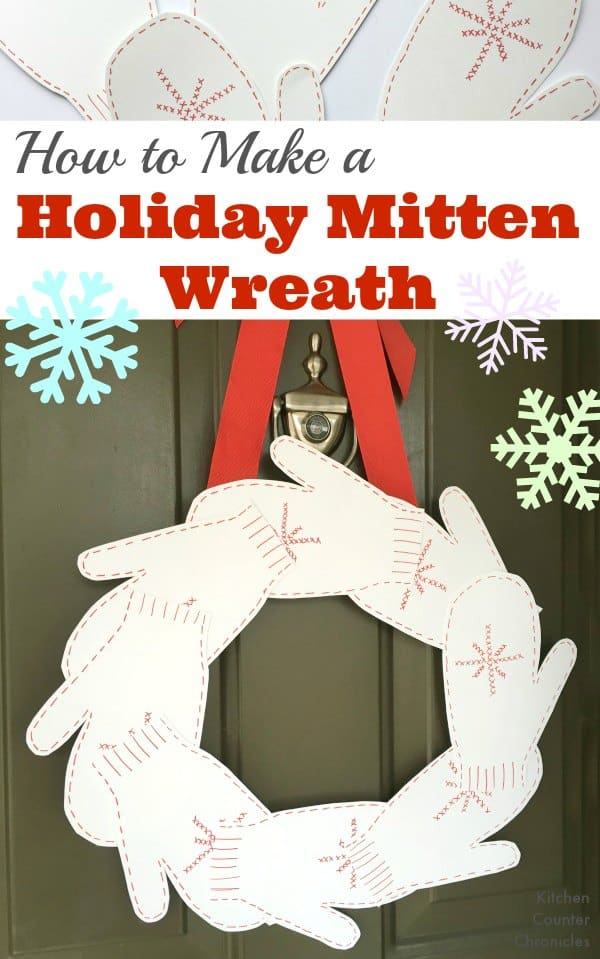 How to Make a Holiday Mitten Wreath - How lovely is this mitten wreath. Perfect wreath to leave hanging all holiday and winter long. Trace your child's hand to create this unique wreath. | Christmas Craft for Kids | Wreath Craft | Winter Craft for Kids |