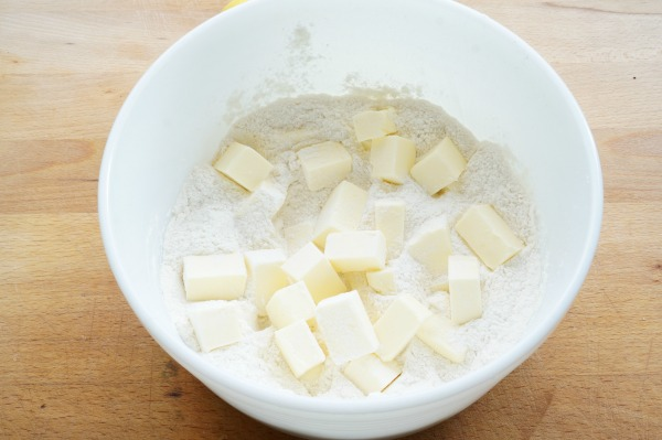 lemon bars with butter in bowl