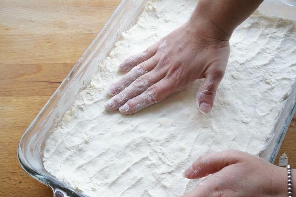 lemon bars pressing crust into baking pan