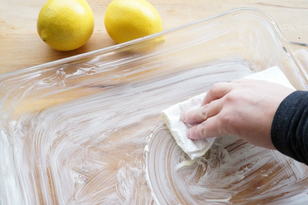 lemon bars buttering baking pan