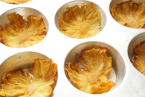 dried pineapple flowers in muffin tin