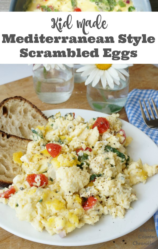 Kid Made Mediterranean Style Scrambled Eggs - Kids love Greek flavours and these scrambled eggs are a healthy and creamy recipe that kids can help make. | Greek Recipe | Egg Recipe | Kid Friendly Recipes | Breakfast Recipe