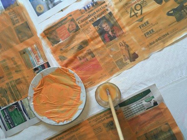 Newspaper pumpkins with paint
