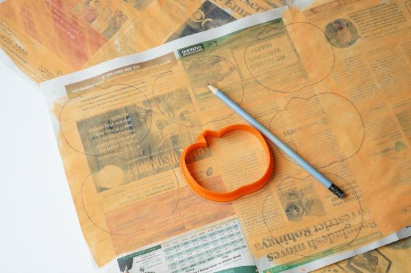 Newspaper pumpkins with cookie cutter