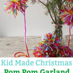 Boho Christmas Pom Pom Garland - A lovely kid-made Christmas garland inspired by Amelia from The Girl Who Saved Christmas. | #kidmadeornament #christmas #christmaskids #bohochristmas #bohopompomgarland #kidmadeornament