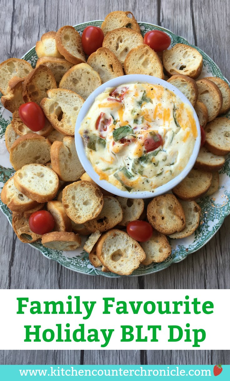A crowd pleasing appetizer that is perfectly festive (or perfect anytime of the year). Packed with bacon, tomatoes, cheese and more. | #Christmasappetizer #baconrecipe #appetizerrecipe #bltrecipe #familyrecipe #christmas #diprecipe