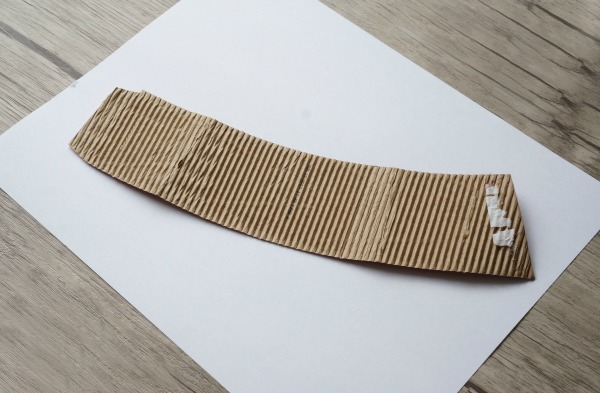 coffee cup sleeve on paper