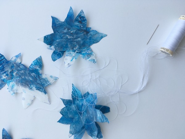 snowflakes with needle and thread