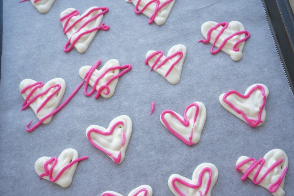 white chocolate hearts with pink chocolate squiggles