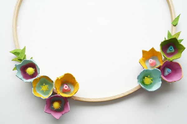 egg carton flowers glued on hoop