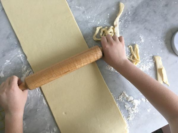 rolling dough for croissants