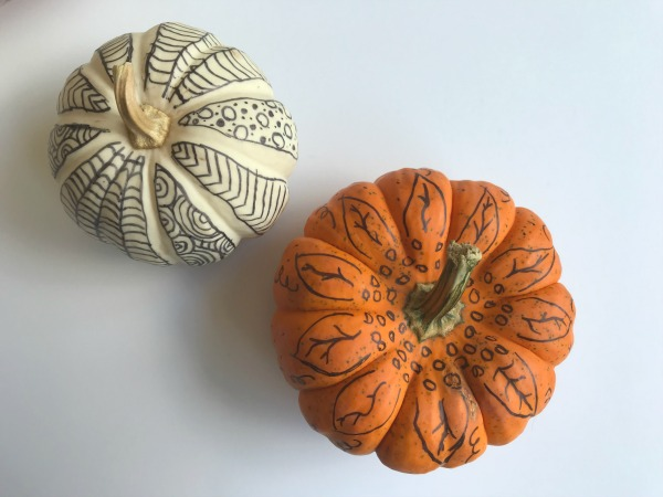 pumpkins decorated with markers