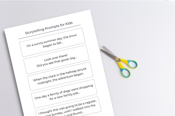 storytelling prompts for kids printed out on table with scissors