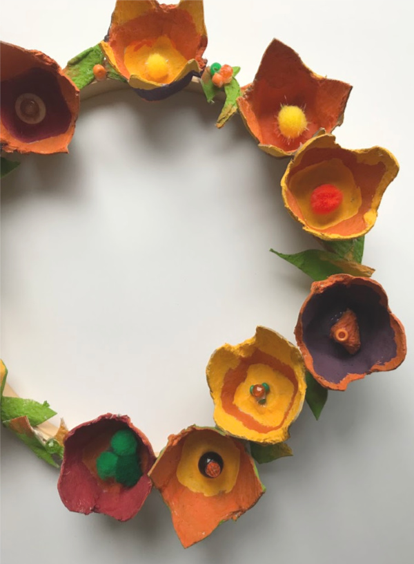 egg carton flowers on wreath close up