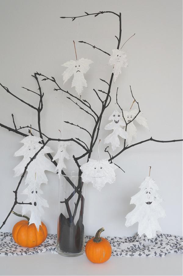 vertical image of halloween leaf ghosts in halloween tree