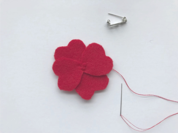 felt poppy pin with the petals sewn together
