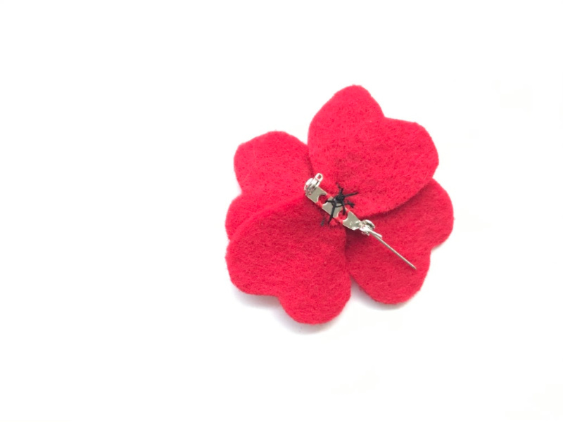 remembrance day poppy pin with pin sewn in place and centre