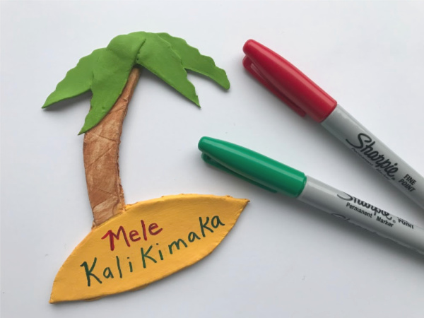 palm tree with mele kalikimaka
