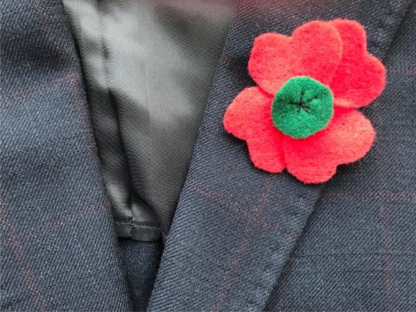 remembrance day poppy pin on jacket