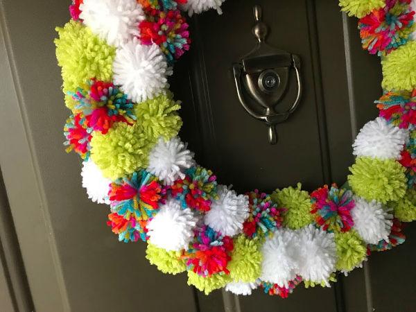 pom pom wreath close up on door