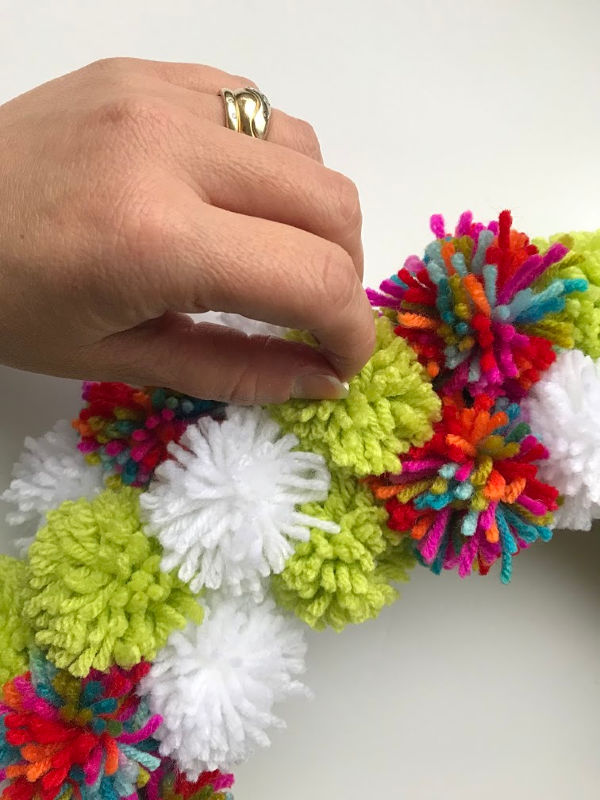 pom poms pinned on wreath