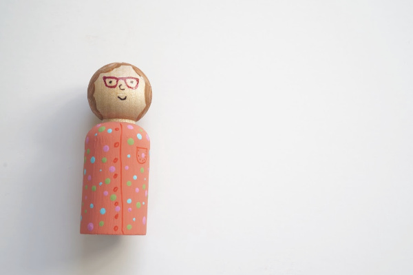 peg doll with face on