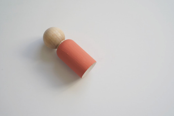 wooden peg doll with painted top