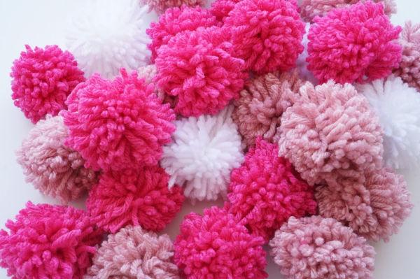 pile of pink pom poms