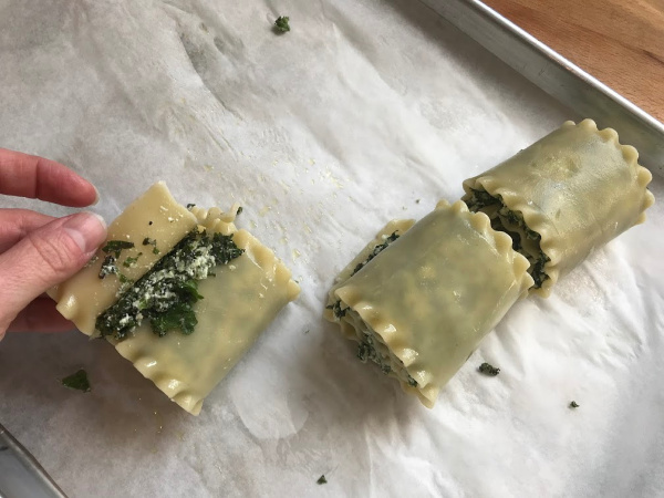 lasagna rolls being rolled up