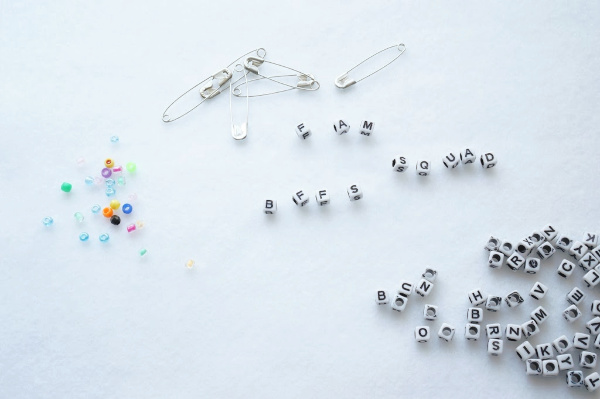 friendship pin letter beads planning out the words