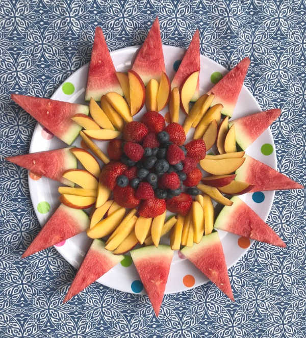 fruit platter with berries in middle of the fruit tray