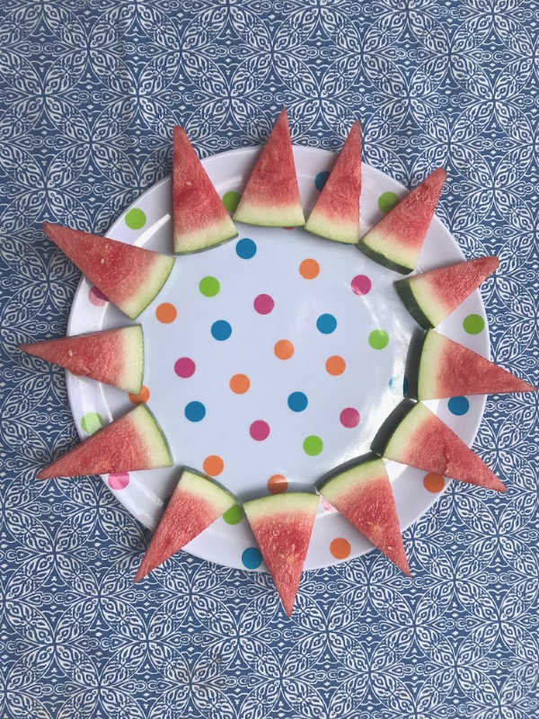 rim of watermelon triangles around edge of fruit tray